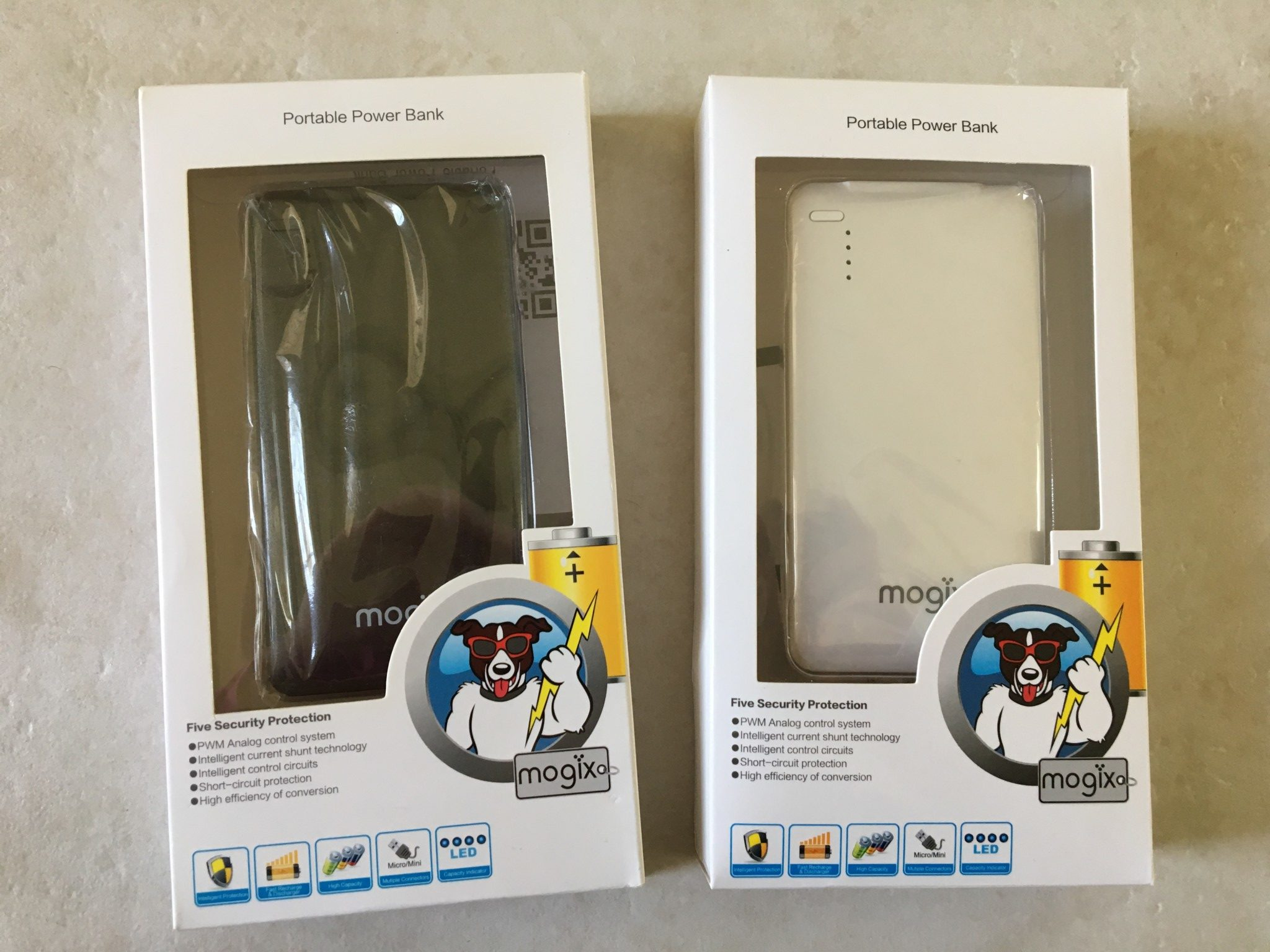 The black and whiite Mogix Portable Chargers