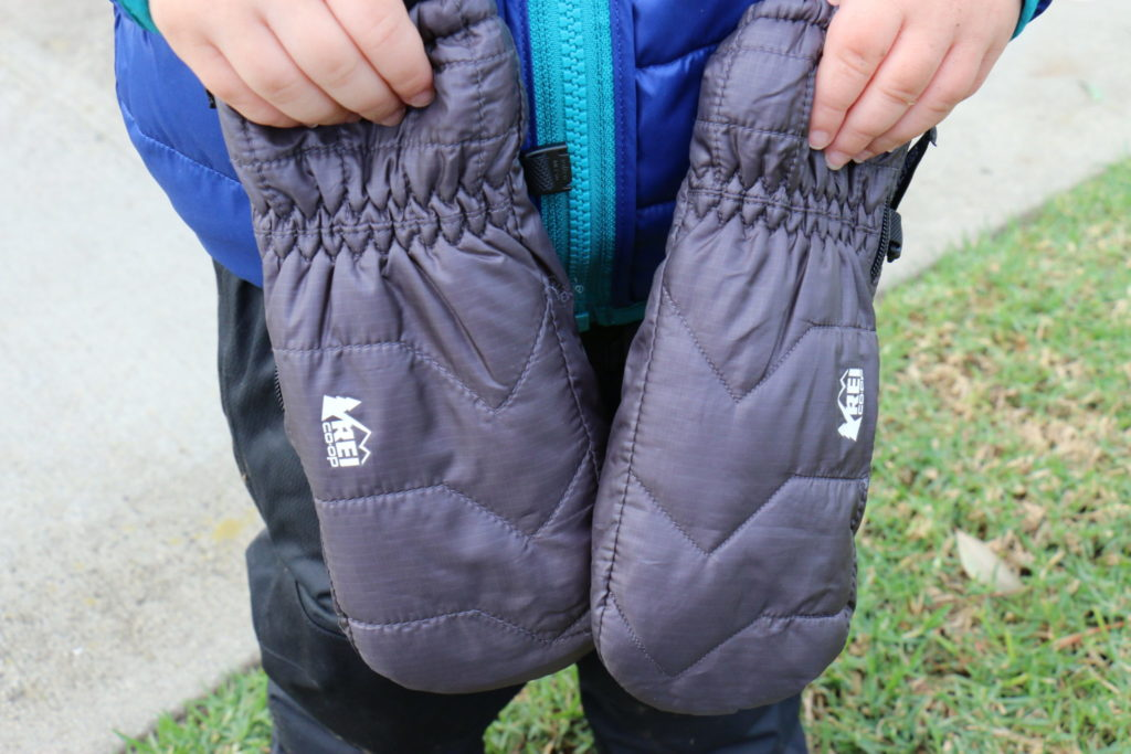 Hiking Toddler showing off his new REI Co-op Puffy Mitts.