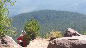 The view plummets beyond this other hiker