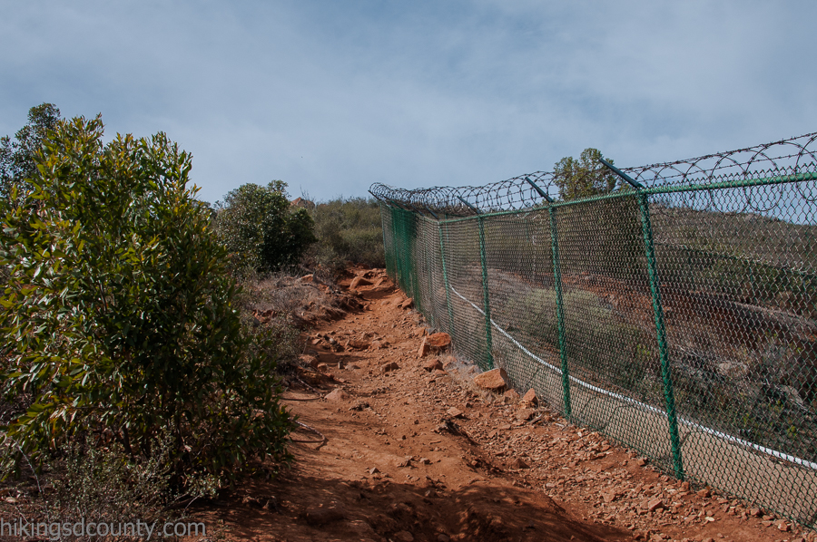 The Bernardo Mountain Summit Trail wraps around a fenced off water tower