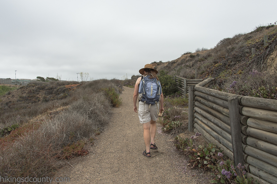 A short gravel path leads from the beach parking area up to the Monument Picnic Area