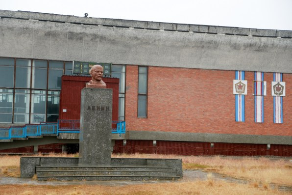 Lenin standing guard in front of the main square in Pyramiden
