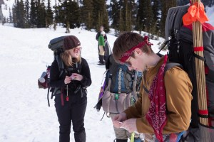 A group of snowshoers checking the map