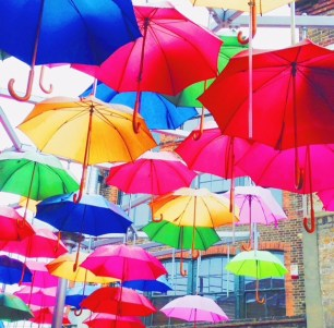 colorful umbrellas covering the outdoor courtyard