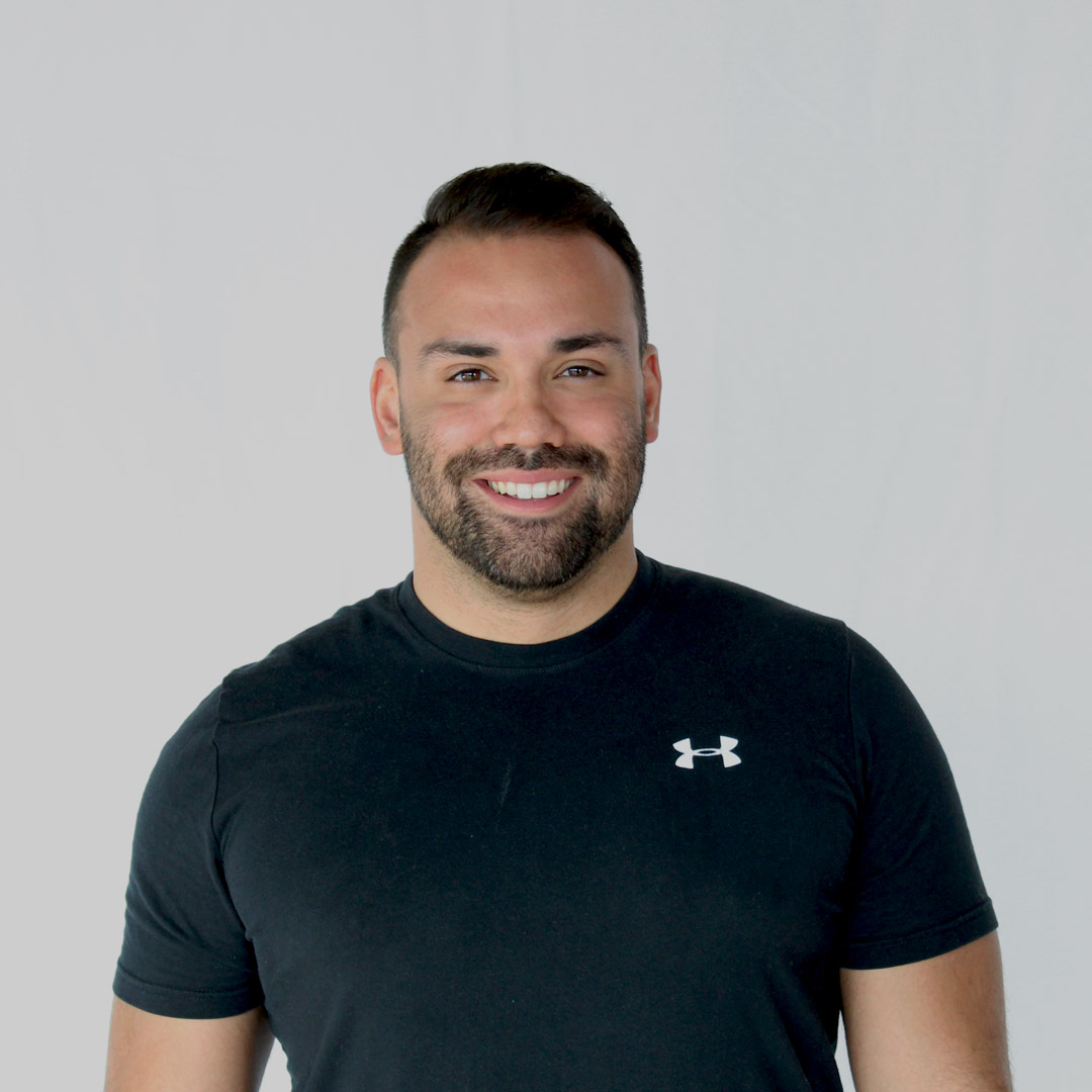 Man wearing a black Under Armour shirt and smiling