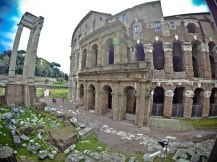 Looks like a smaller Colosseum - this is the Teatro Marcello in Rome