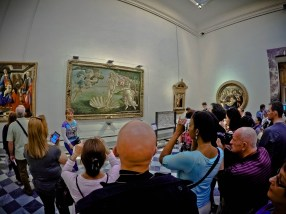 Tourists surround the famous painting