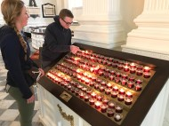 Lighting a candle in Trinity Church