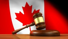 a judge's gavel and the Canadian flag in the background