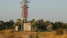 Telecommunications transmitter in a field. Photo: Thinkstock.com