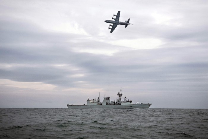 Photo: A Royal Canadian Navy frigate and a Royal Canadian Airforce surveillance aircraft