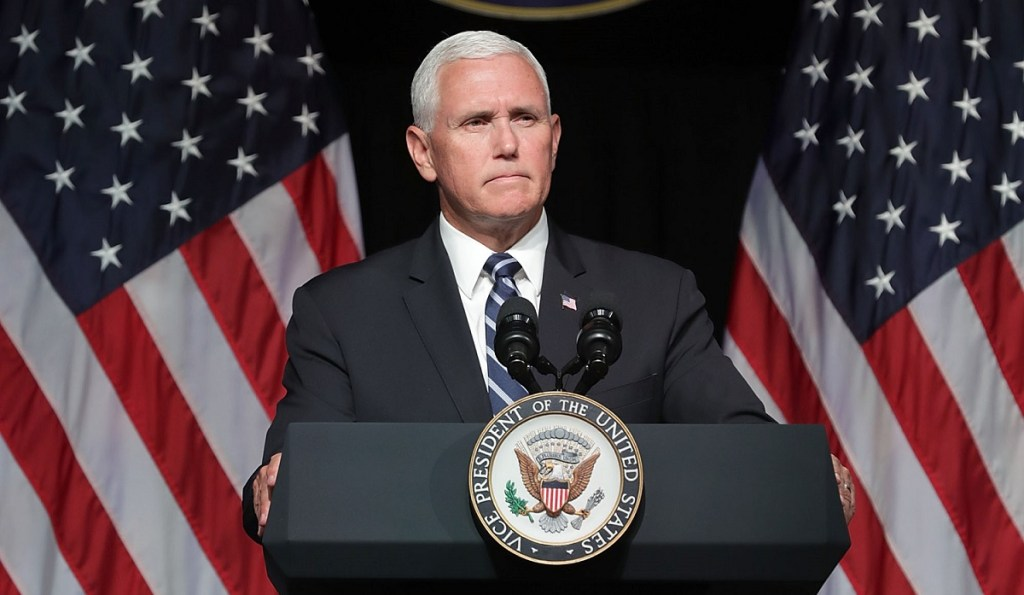 Mike Pence holds maskless rally