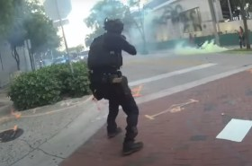 police call protesters f***ers, attack
