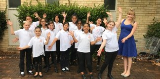 Some of the members of the Sydney Hills Youth Choir with conductor and organiser Cassidy-Rae Wilson.