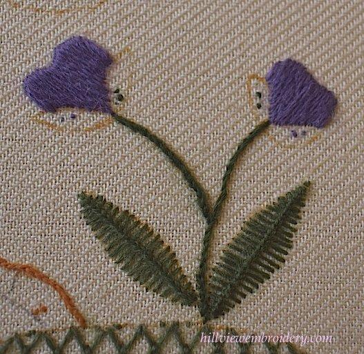 traditional crewel work stitches of stem stitch, satin stitch and van dyke stitch