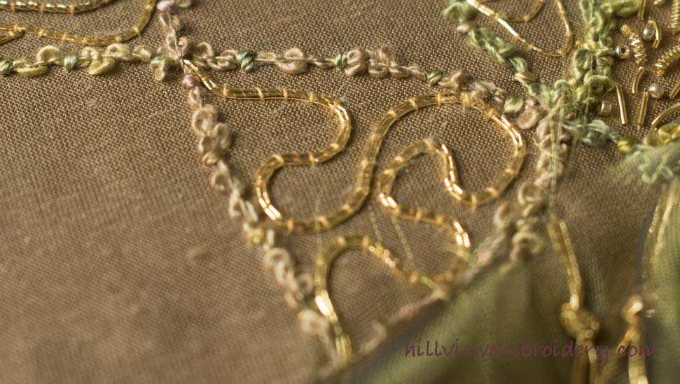 Using non-traditional methods, interest has been created using gold couching thread