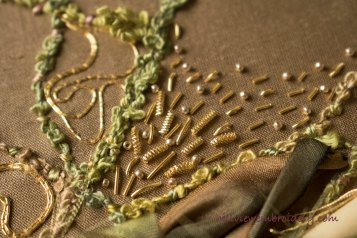 using gilt purl thread and pearl beads to add interest and contrast to a sampler