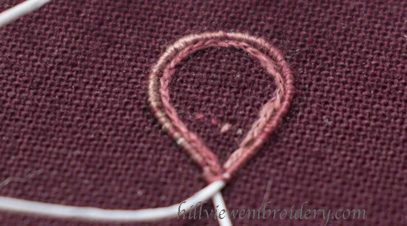 An example of overstitching the wire and applying split stitch before long and short stitch is applied