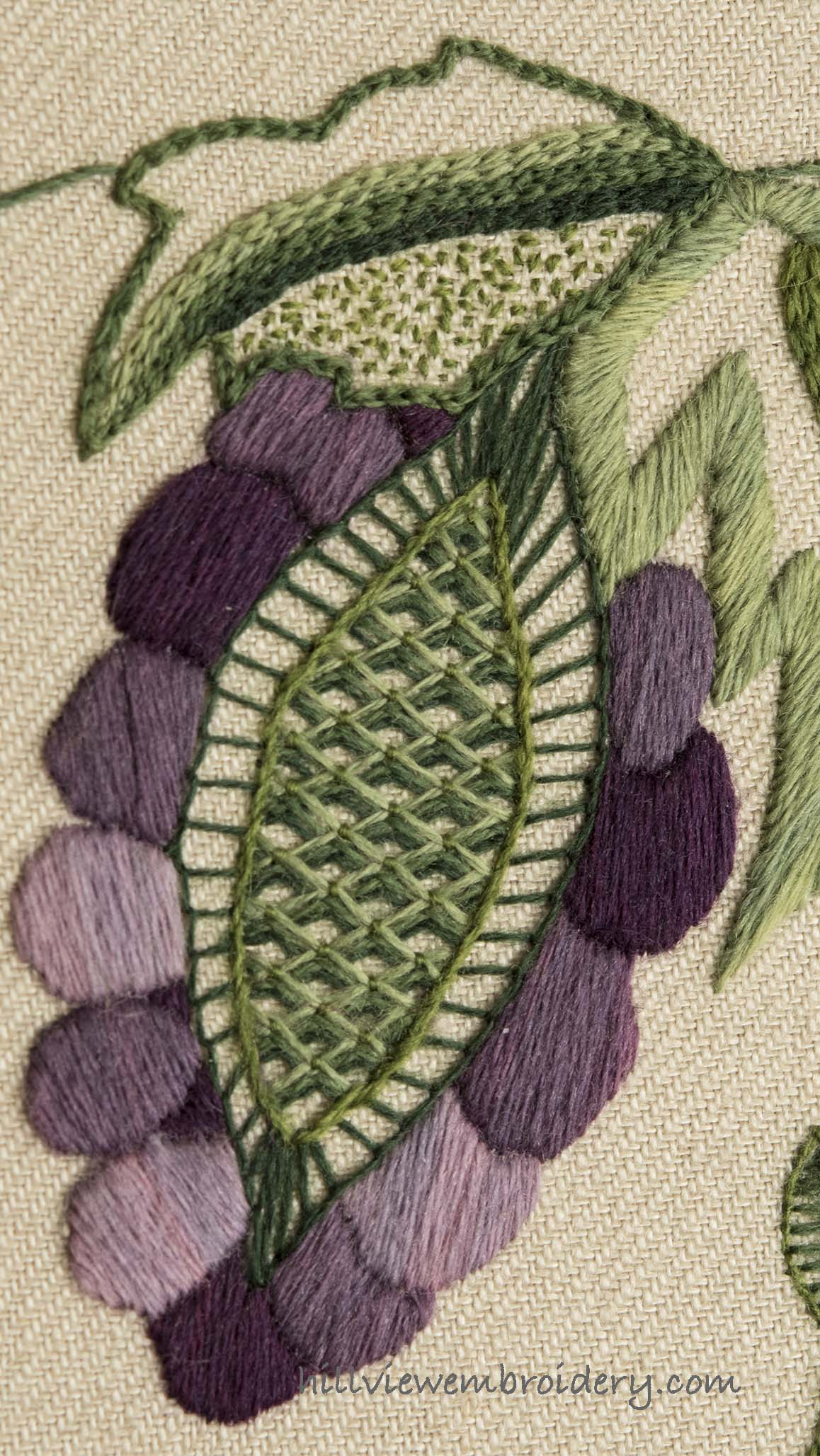 Grapes on this crewelwork piece are enhanced by beautiful colour choices