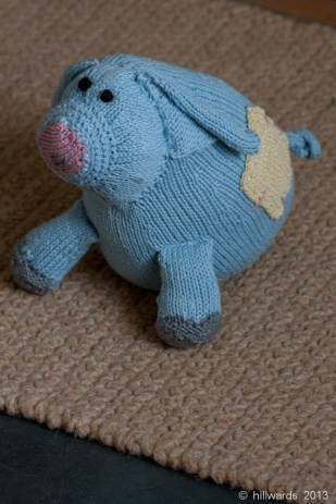 Rosie Pig angled front view - knitted soft toy in Rowan Purelife organic cotton DK.