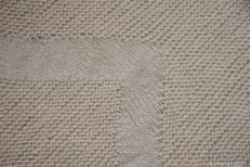 Detail of stocking stitch band on diagonal garter stitch