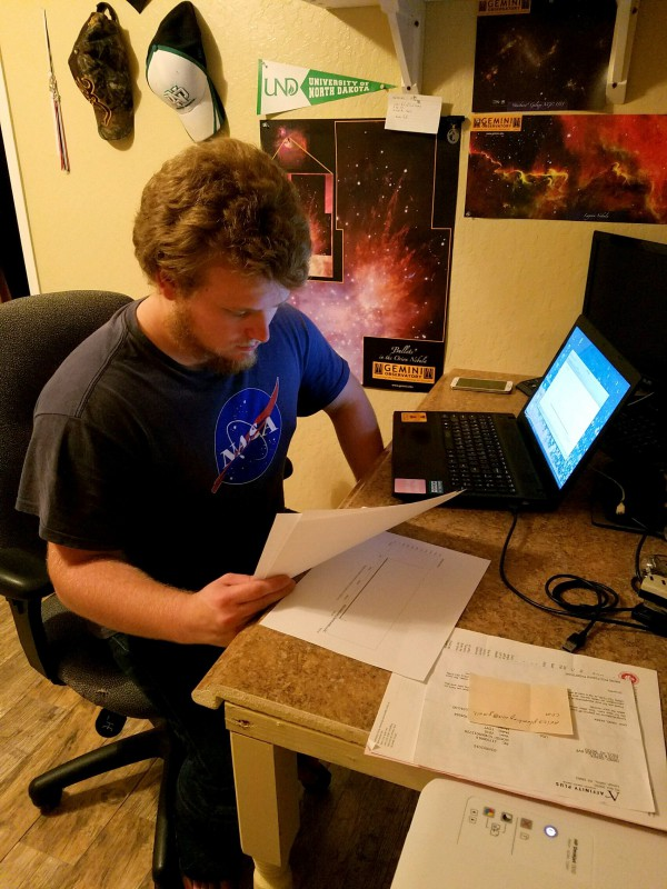Derek Hand working on his research project.