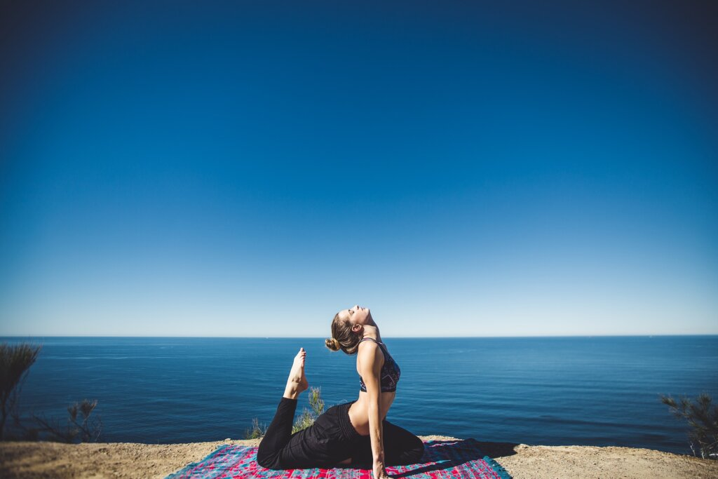 Girl doing yoga in open area