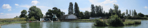 Photo of Mill Rythe Lake and the club house