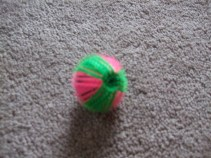 Small, spiky, green and pink wash ball