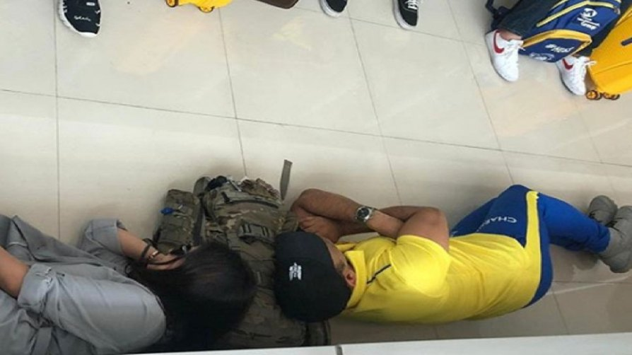 Dhoni lying on airport