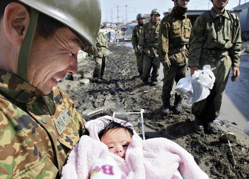 soldiers-rescue-a-4-month-old-baby-girl-who-went-missing-for-4-days-after-the-japanese-tsunami-in-march-2011