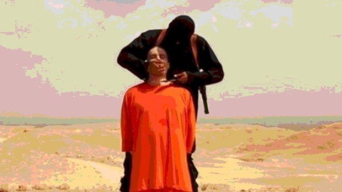 कट्टरपंथी इस्लामी आतंकी द्वारा सर काटने की तस्वीर