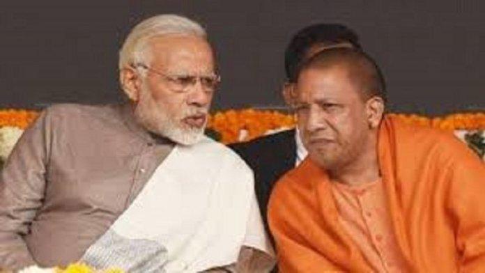 प्रधानमंत्री नरेंद्र मोदी के साथ उत्तर प्रदेश के मुख्यमंत्री योगी आदित्यनाथ (फ़ाइल फोटो)