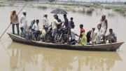 Bihar Flood, people on boat