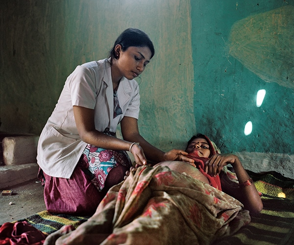 midwife tends pregnant woman
