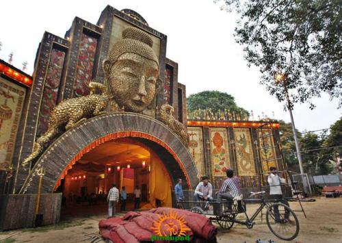 Arambagh Durga Puja 2013 – 16-feet tall and 12-and-a-half feet wide Buddha idol is a part of a Durga Puja pandal in Delhi