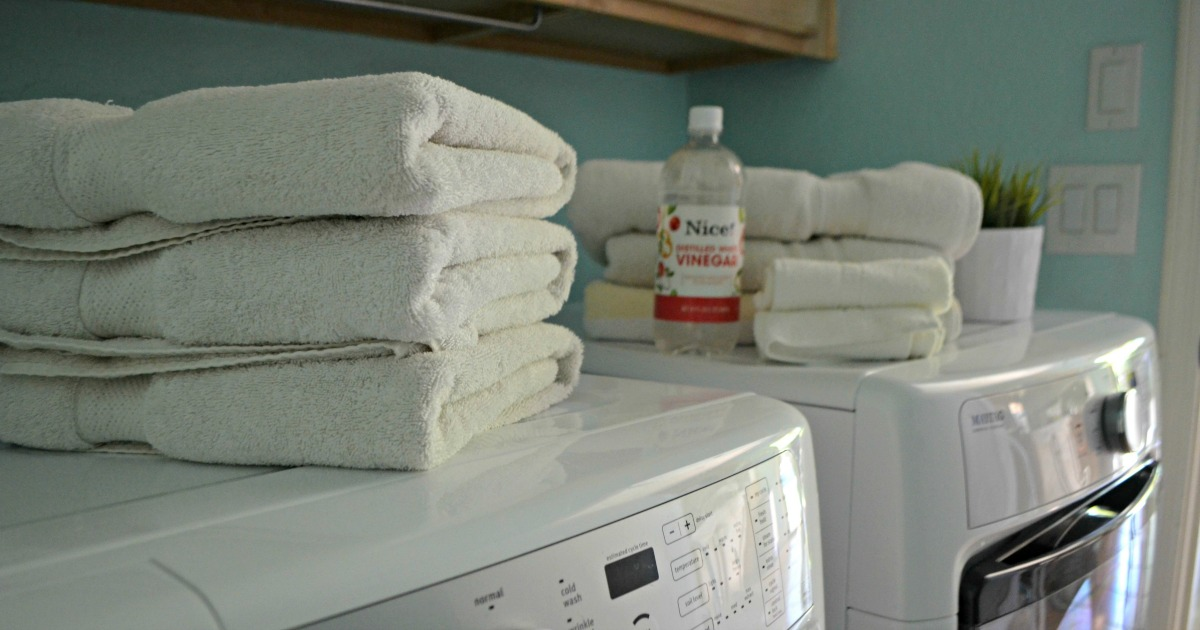 Costco Charisma towels stacked on the washer and dryer
