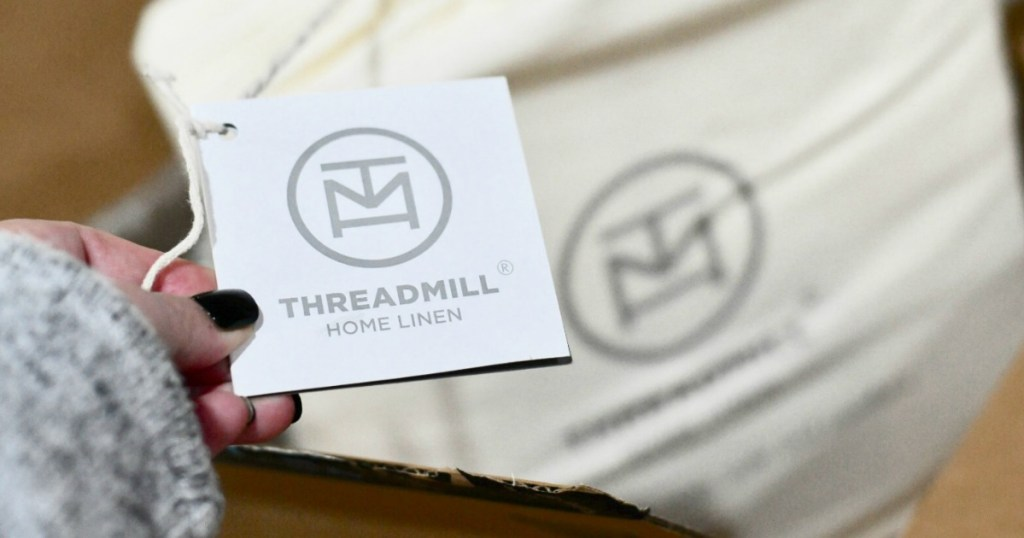 holding Threadmill Home Linen cotton sheets tag