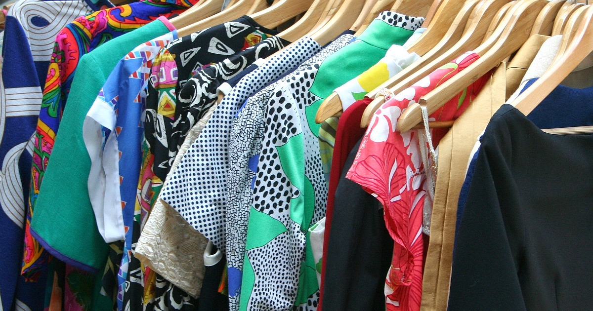assortment of bright clothes on hangers