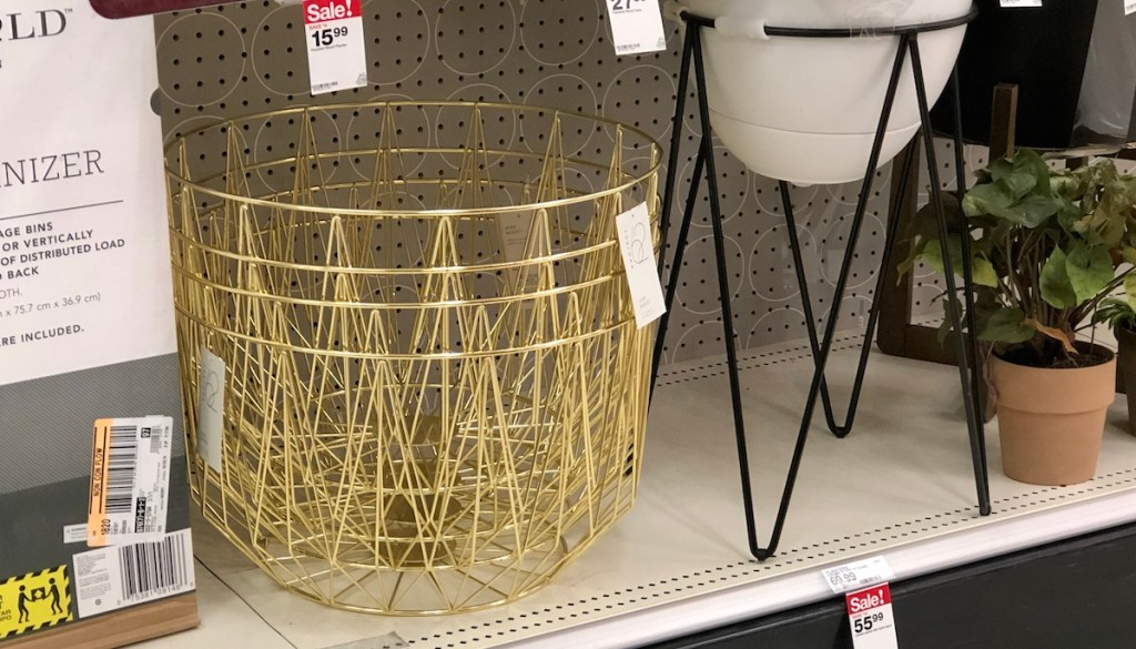 gold wire metal baskets stacked in a pile on shelf