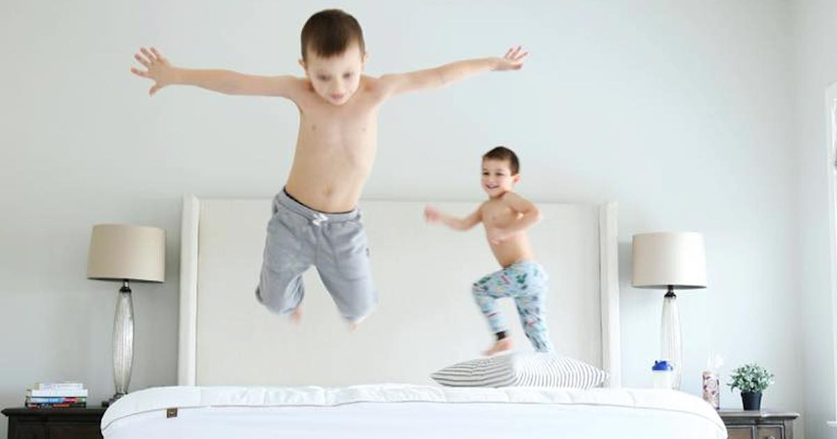 how often do you clean your bed - boys jumping on mattress