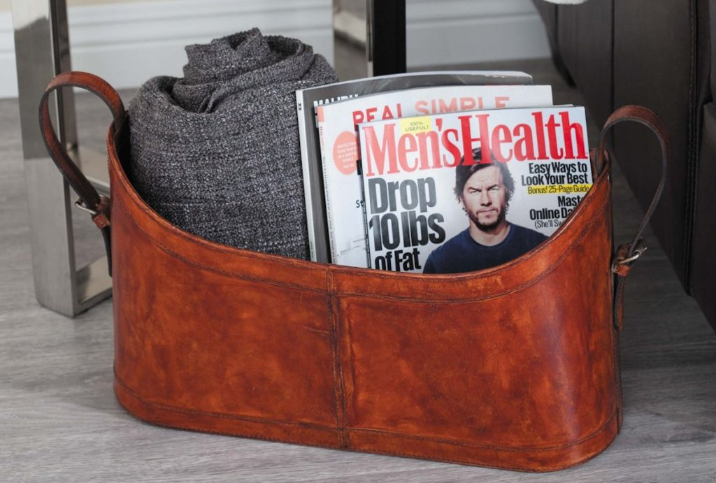 leather basket with blanket and mens health magazines inside