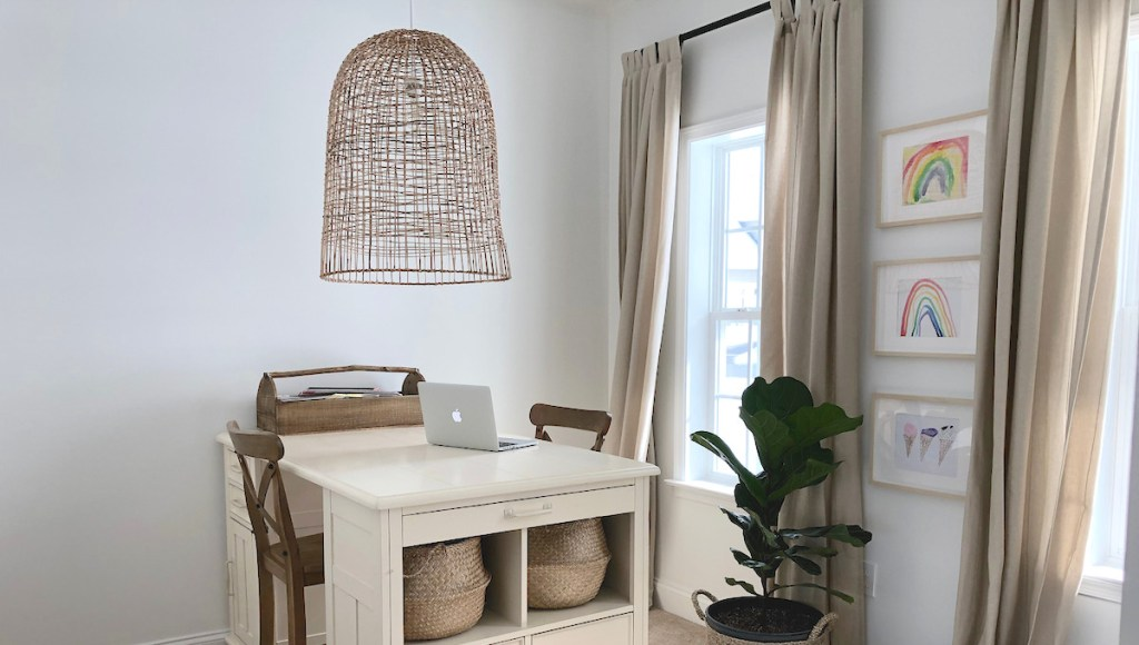 large basket light in office with desk plant artwork on walls and computer