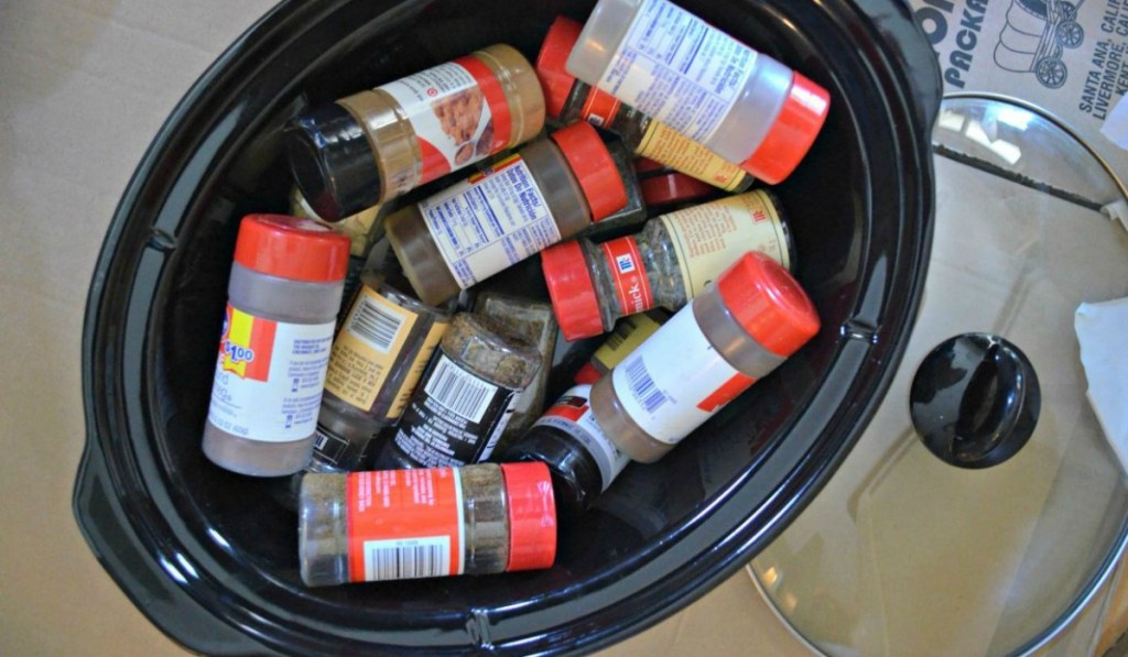 spices stored in slow cooker for moving