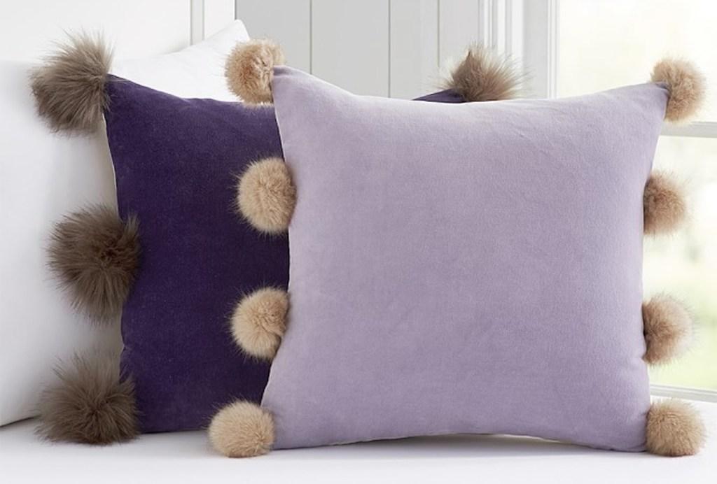 pottery barn kids velvet plum and lavendar throw pillows with pom poms