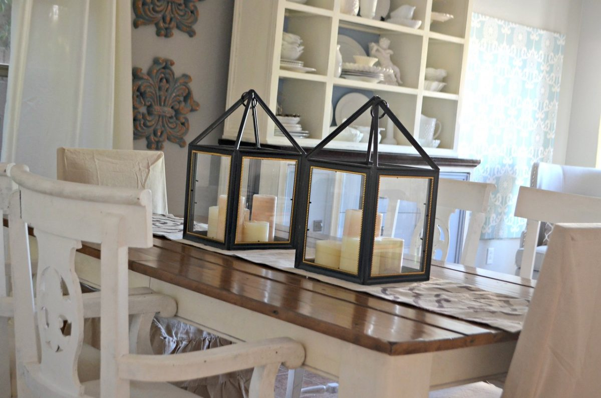 homemade decorative lanterns from dollar tree frames on a wooden table