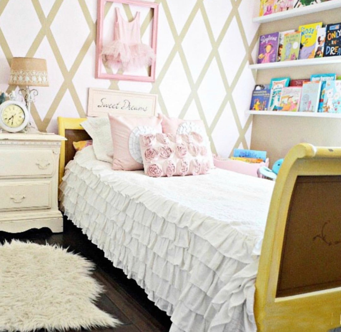 pink and white girls room with ruffle bedding