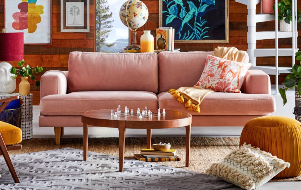 pink living room with sofa and other decor