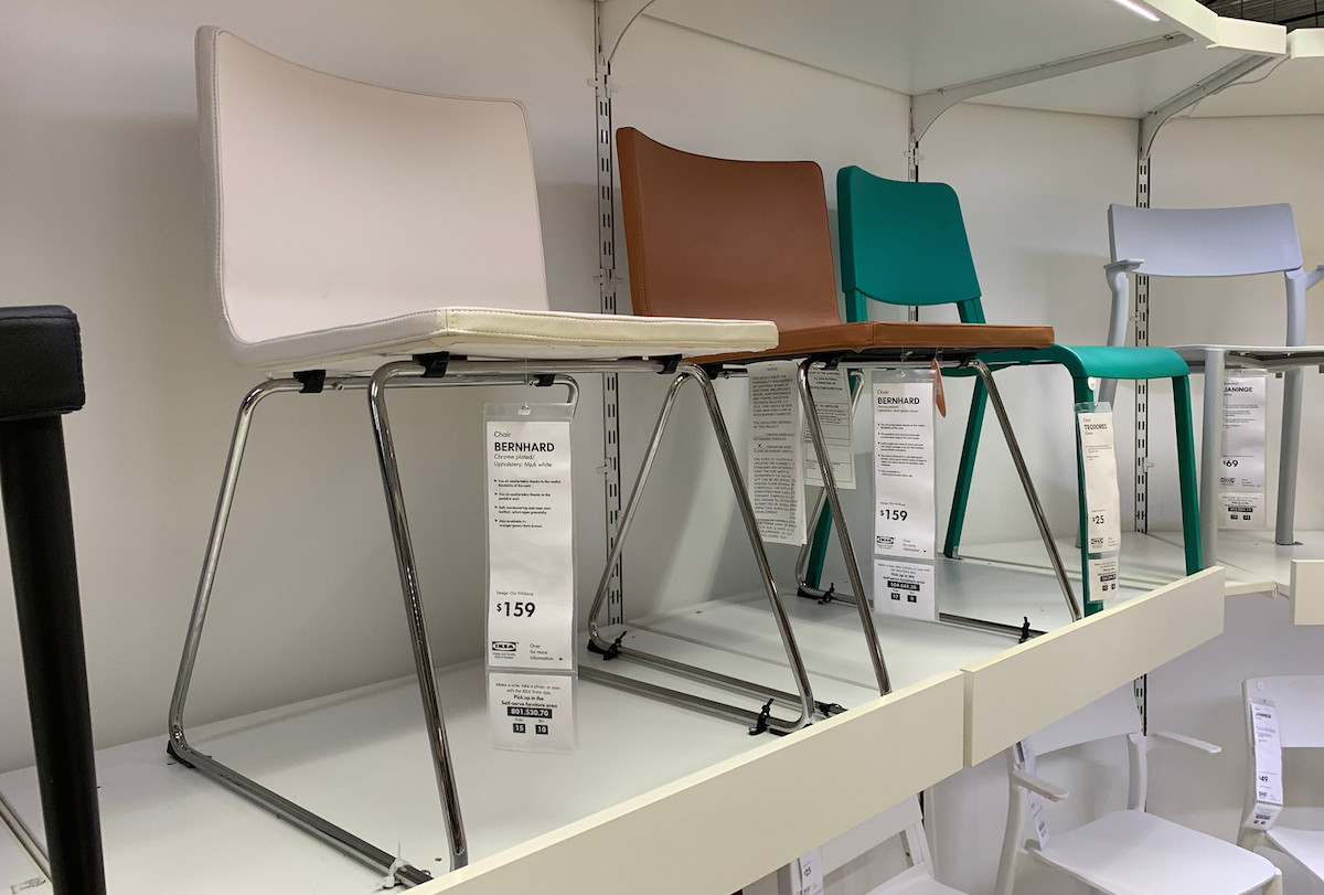 row of white brown blue chairs sitting on white store shelf