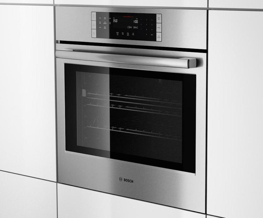built in modern stainless steel wall oven with sleek white cabinets surrounding it